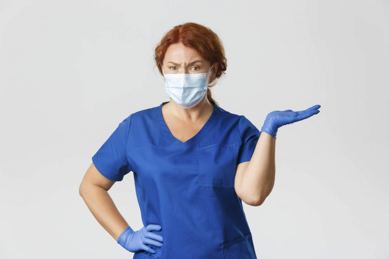 female dental worker with mask and gloves on